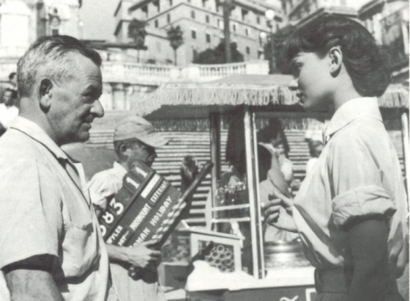 Audrey Hepburn wallpaper possibly containing a newsstand entitled Behind the scenes of Roman Holiday