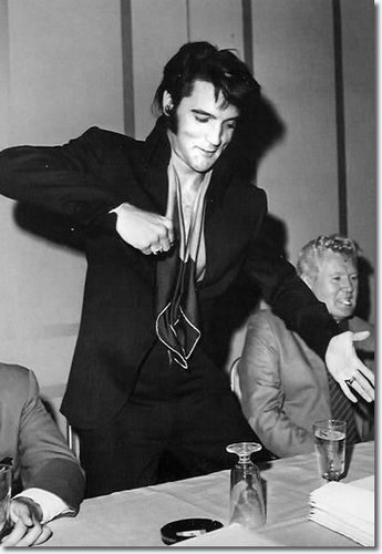 Elvis Presley wallpaper probably containing a business suit, a sign, and a well dressed person called Elvis 1969