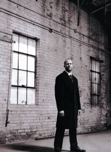 Jason Statham wallpaper containing a business suit, a street, and a well dressed person entitled jason statham