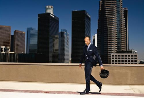 Jason Statham wolpeyper with a business district and a business suit called jason statham