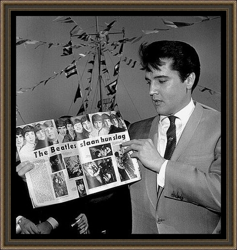 Elvis Holding A Magazine Showing The Beatles