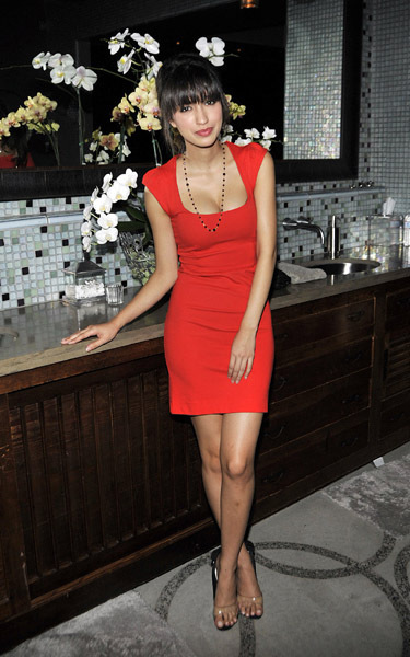 http://images2.fanpop.com/images/photos/8100000/Christian-Carly-Steel-s-Black-Dahliance-Birthday-Party-christian-serratos-8186951-375-600.jpg