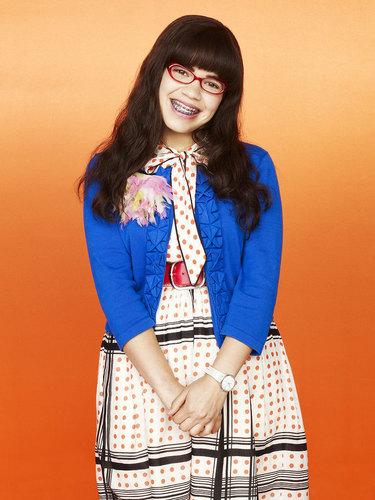 丑女贝蒂 壁纸 possibly containing an outerwear, a well dressed person, and a box 涂层, 外套 titled Season 4: Betty Suarez
