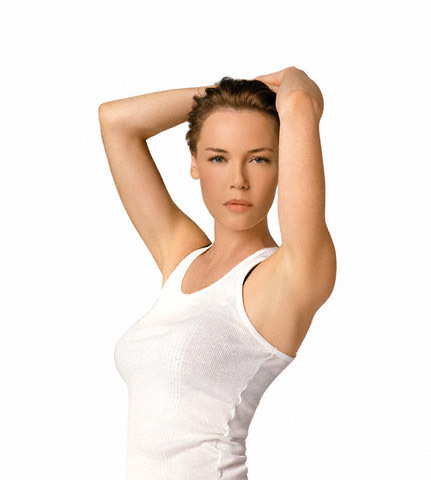 Pelakon wanita kertas dinding probably with a leotard and tights titled Connie Nielsen