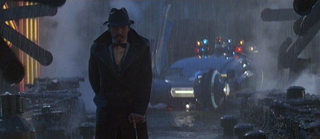 http://images2.fanpop.com/images/photos/8200000/Edward-James-Olmos-as-Gaff-in-Blade-Runner-blade-runner-8239983-652-285.jpg
