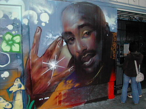 Tupac Shakur wallpaper probably with a sign entitled 2pac