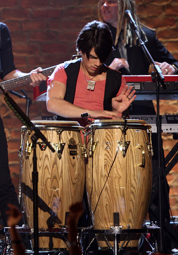 Joe Jonas on conga drums