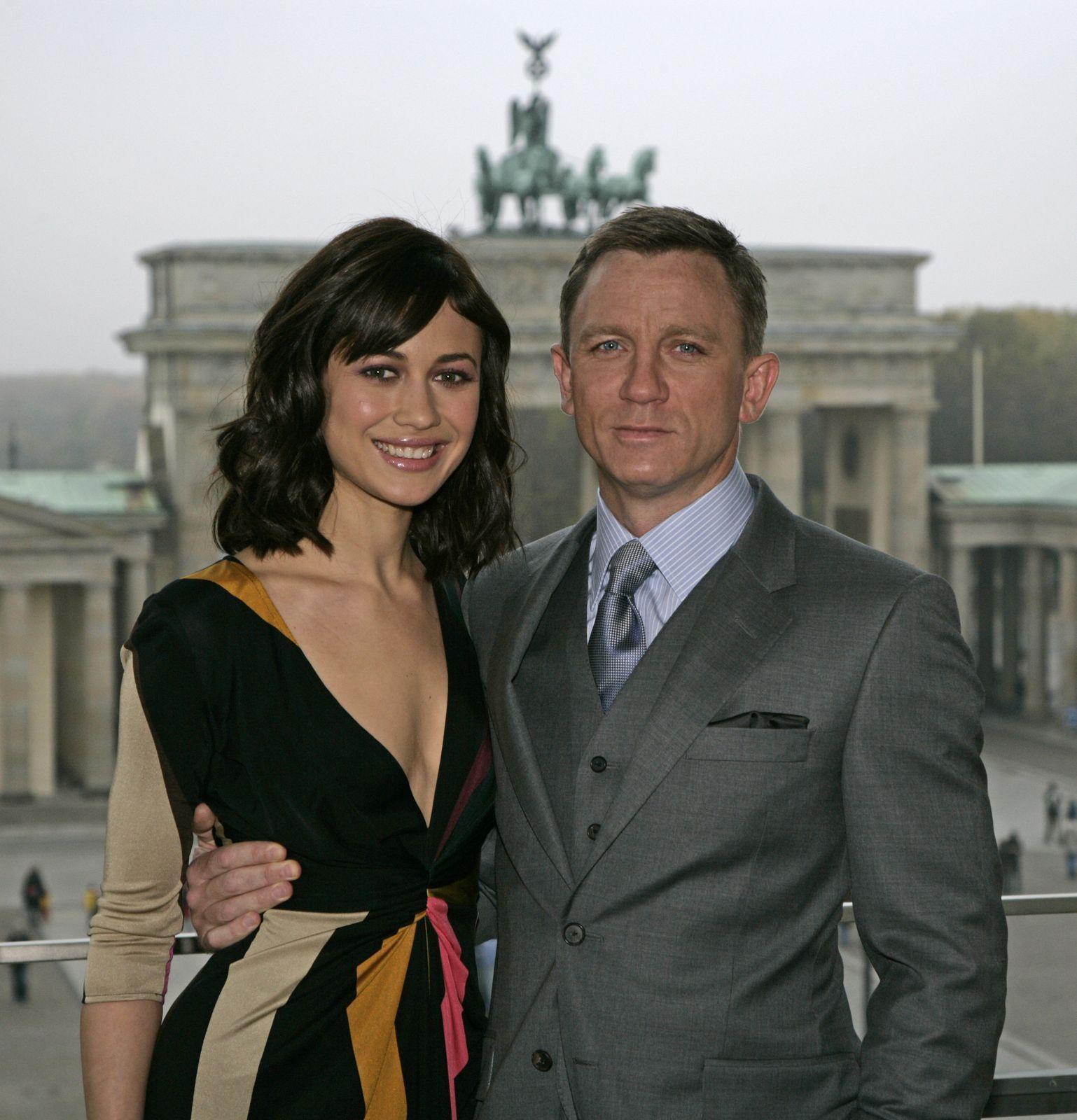 Olga Kurylenko   Photocall in Berlin w/ Daniel Craig