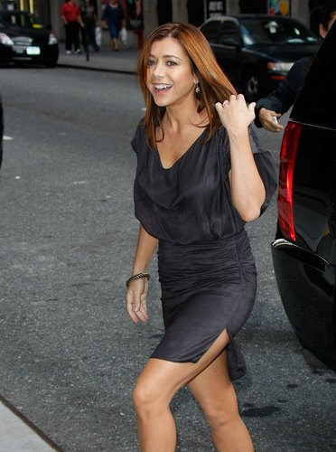 Alyson Hannigan wolpeyper possibly with bare legs, hosiery, and a hip boot titled Alyson - Letterman