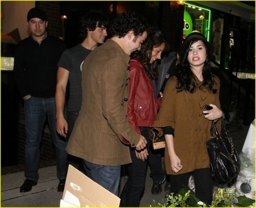 The Jonas Brothers wallpaper probably containing a street, a box coat, and an outerwear titled Joe, Demi, Kevin & Danielle in Toronto