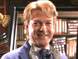What book was Gilderoy Lockhart autographing in Flourish & Blotts when Harry met him?