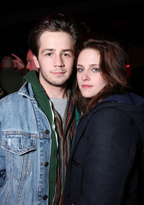 Which magazine did Kristen first confirm that she is dating actor Michael Angarano?