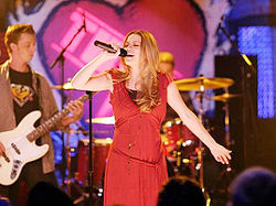 In this photo of One tree hill, which song is Haley(Bethany)performing?
