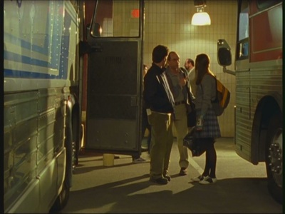 When Rory is at the Bus Station in New York heading for home what street does a tourist ask her the directions for?