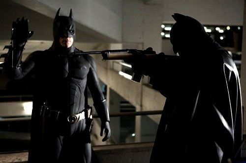 "How many ""fake Batmans"" appear in one of the first scenes in the film?  This scene is the one in the parking lot that features the Scarecrow."