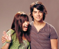 During a recent interview when Joe was asked if Demi was like a sister to them, what did he say?
