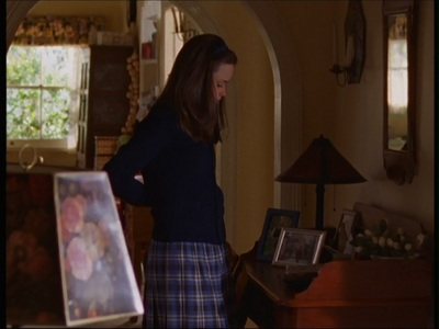 In episode 2x20, Lorelai leaves Rory a message saying she'll be inicial late and to get pizza, where does she say she left the money?