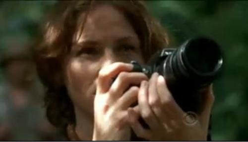 "In the end of ""One To Go,"" what was Sara photographing?"