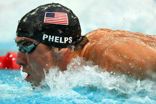 Where did Michael Phelps win his first gold medal?