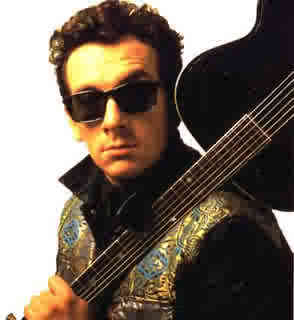 "In ""What a Catch, Donnie"" what song does Elvis Costello sing lines from?"