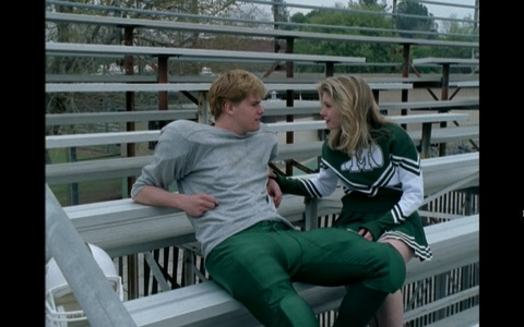 What are the names of the jock and cheerleader couple right in the beginning of the pilot?
