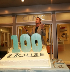 What does House call his walking stick in the 100th episode?