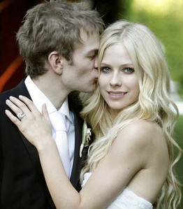 When did Avril and Deryck get married?