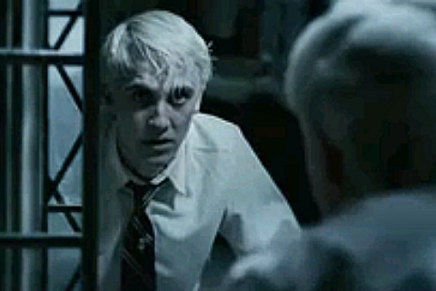 What does Draco say to Harry in the Bookstore?