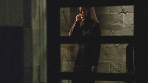 In this scene, Lauren is contacting Sark and providing him with information about what?