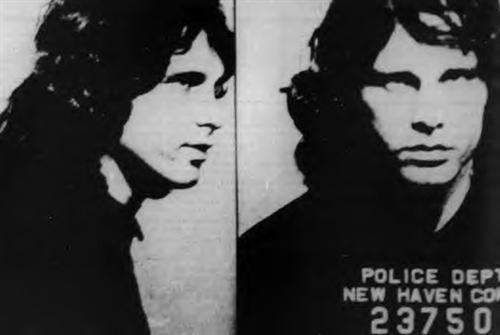 When the cops showed up on-stage at the show in New Haven, CT to arrest Jim Morrison, Jim reportedly shoved the microphone in one of the cops' faces and said what?