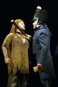 "What did Valjean steal that turned him into ""a slave of the law""?"