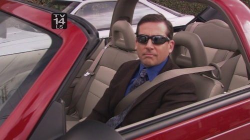 What song is playing in Michael's car at the beginning of 'The Michael Scott Paper Company'?