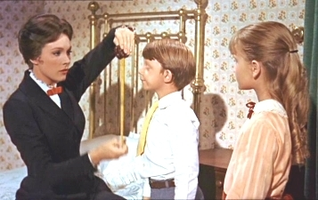 When Mary measures Michael with the tape measure, what does it say about him?