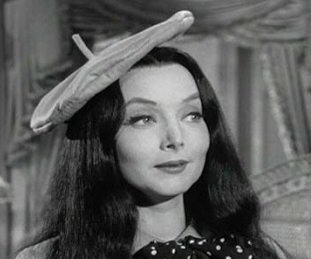 Who played Morticia in The Addams Family original tv show?