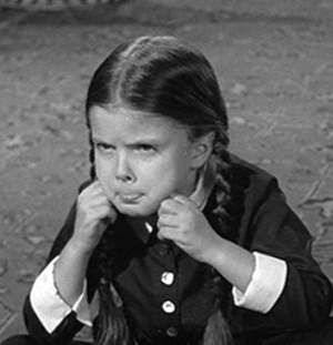 Who played Wednesday in The Addams Family original tv show?