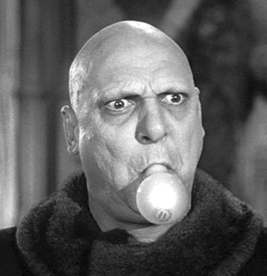 Who played Uncle Fester in The Addams Family original tv show?