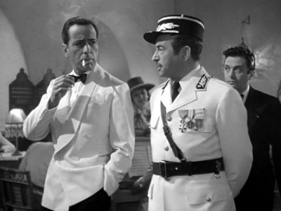 When asked why he came to Casablanca, what does Rick say?