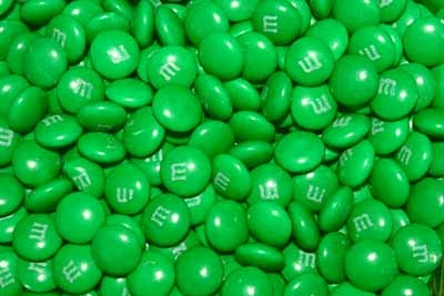In commercials for M&M candies, how is the character that represents the green M&M different from the others?