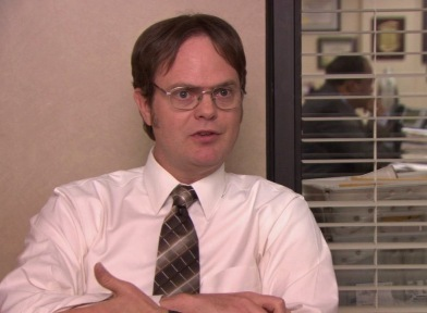 FROM 'HEAVY COMPETITION': What is NOT a comparison Dwight uses to describe the office when Michael was in charge?