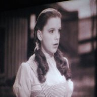 A Blooper- In one scene Dorothy trips over something,Do you know what it is?
