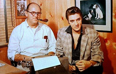 Who is Elvis seen here with?
