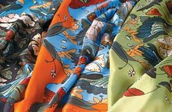 What colour shopping bags are the Hermès scarves in?