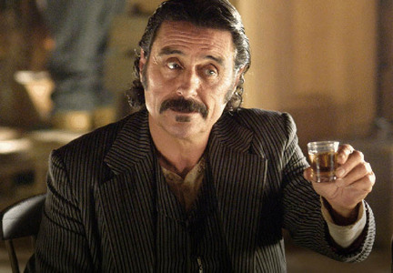 "In episode 1, ""DEADWOOD,"" how much money does Al Swearengen offer as a personal bounty for every decapitated Indian head?"