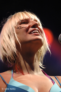 What is the name of the band that Sia collaborated with?