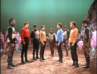 In The Day Of The Dove, the alien entity isolates all but _______ members of the Klingon and Enterprise crew.