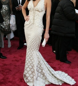 FASHIONS: Which actress won her first Oscar while wearing this mermaid gown?