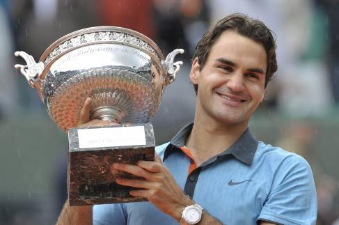 After winning the 2009 French Open how many grand slams has Federer won?
