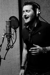 In the picture below, which famous musician's microphone is Paul singing in to?