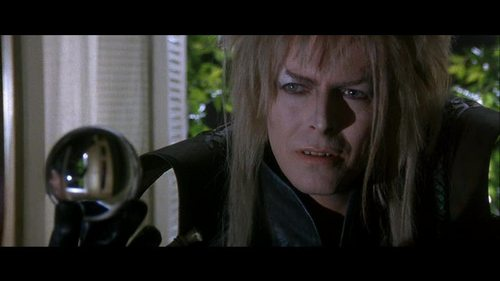 After Jareth first offers Sarah her dreams and she declines saying she wants her brother back, what happens to the crystal ball Jareth's holding?