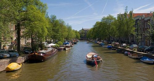 PASSPORT FUN: While visiting this beautiful city, you enjoy a boat ride down the Grachtengordel canal. Where are you?